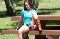 Watch this porn, it is so hot to see a girl petting her cunt on the bench in the park. She is so risky, anybody could see how she teases her pussy through her slutty black lingerie.