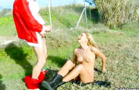 Fabulous blonde hottie is deeply penetrated outdoors by a Santa
